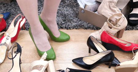 Woman Chooses  Shoes At Fashionable Shop Imagens