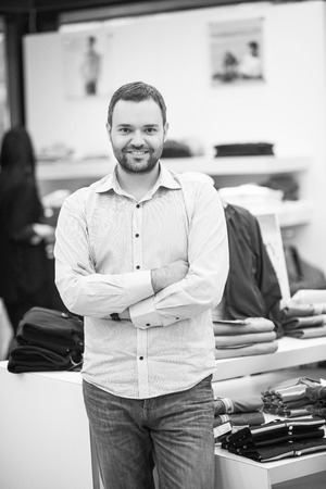 Portrait of an attractive man Shopping In A Mans Clothing Store Reklamní fotografie