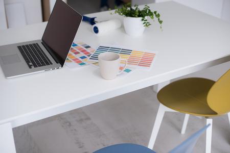 laptop on a white kitchen table