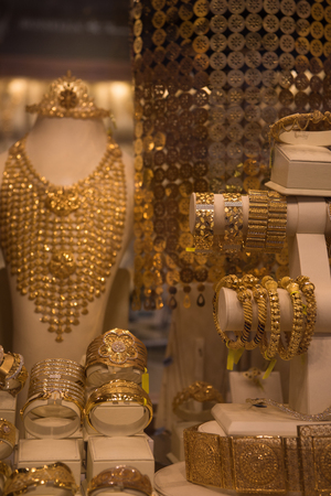 neckless: Fashion jewelry from yellow and white gold, on a window shop