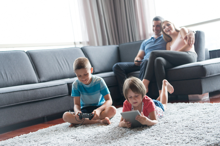 Happy Young Family Playing Together at home