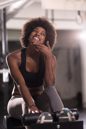 young fit african american woman doing sit ups in fitness studio at the gym.Abdominal exercises Sit up Stock Photo
