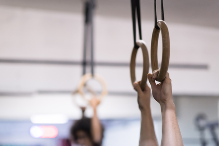 Cropped shot of male hands on gymnastics rings Stock Photo - 81598624