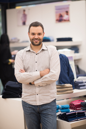 Portrait of an attractive man Shopping In A Mans Clothing Store Stock Photo