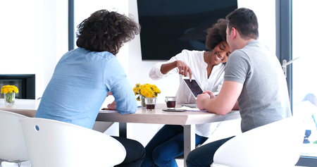 african american woman: Multiethnic startup business team on meeting in modern bright office interior brainstorming, working on laptop and tablet computer