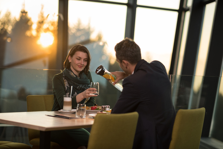 Couple celebrate Valentine's day with romantic dinner in restaurant near the window photo