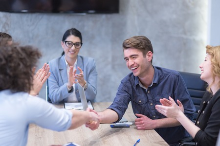 Business Partner Shake Hands on meetinig in modern office building Stock Photo