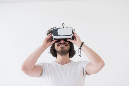 virtual reality simulator: Happy man getting experience using VR headset glasses of virtual reality, isolated on white background