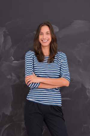 onderwijs: portrait of a young woman standing in front of chalk drawing board