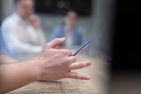 young businessman hand using pen closeup shot