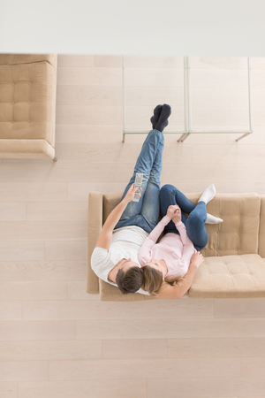 top view of Young couple on the sofa watching television together at home Archivio Fotografico