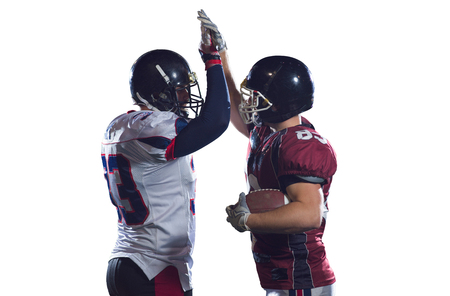 american football players giving high fives after scoring a touchdown isolated on white background