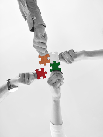 Group of business people assembling jigsaw puzzle and represent team support and help concept Imagens - 94128749