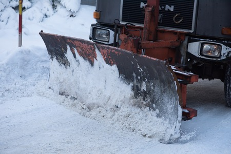 snow truck with plow on winter road cleaning fresh snow Stock Photo - 97635622
