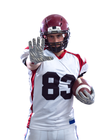 Portrait of American football player pointing against white background