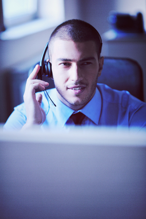 businessman with a headset portrait at bright call center helpdesk support office Banco de Imagens