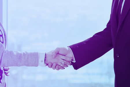 business man and woman handshake on successful  meeting at bright office conference room indoor Stock Photo