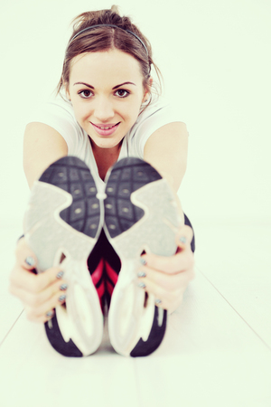 beaudiful young woman fitness workout with weights at sport club Stock Photo