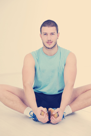 young man in fintess sport club exercise withweights and relaxing Stock Photo