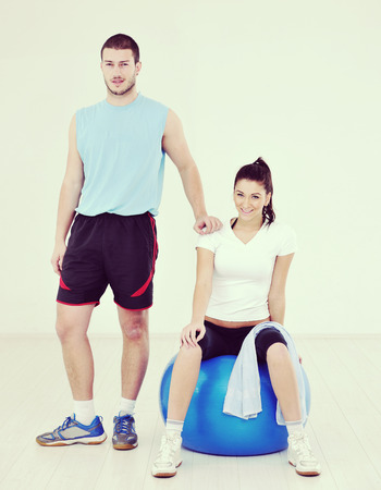 happy young couple fitness workout and fun at sport gym club Stock Photo