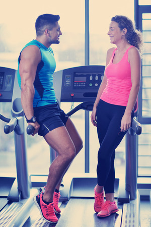 attractive couple at the gym looking happy Stock Photo