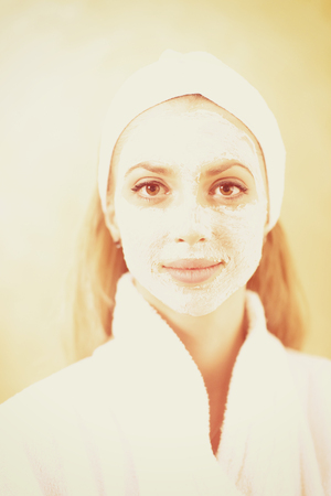 portrait of beautiful woman with cosmetic mask on face in spa and  wellness salon Banque d'images - 100079358