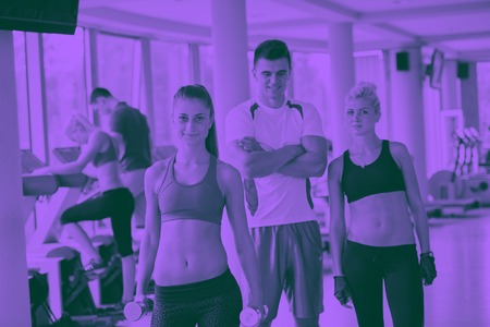 group portrait of healthy and fit young people in fitness gym duo tone 写真素材