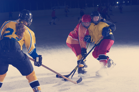 ice hockey sport players in action, business comptetition concpet, teen girls on training Stock Photo