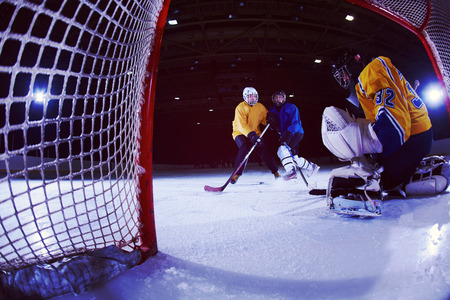 ice hockey goalkeeper  player on goal in action