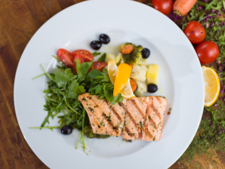 Salmon fillet steak in white plate Healthy food style Stock Photo