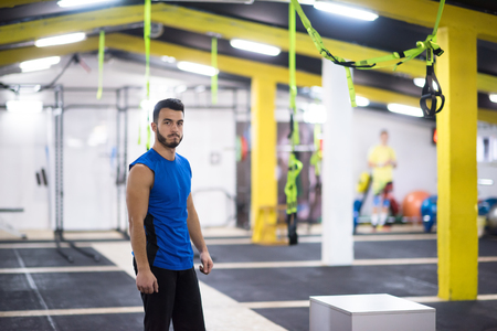 Portrait of young athlete man at cross fitness gym