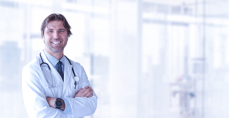 Portrait of smilling senior doctor of medicine in his ordination