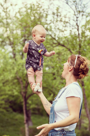 woman with baby have fun in nature Stock Photo