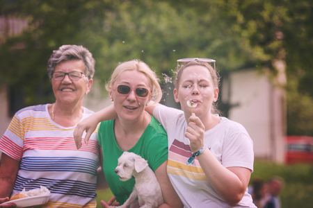 Portrait of grandmother with daughter and granddaughter in park while having fun Stock Photo - 108876638