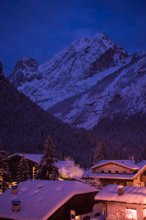 mountain village in alps  at night in winte  with fresh snow 写真素材