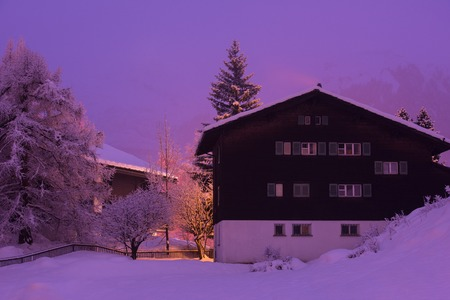 a beautiful landscape with mountain houses in a cold winter night