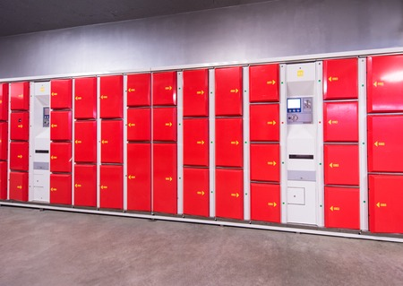 red safety lockers in empty Lockers Room