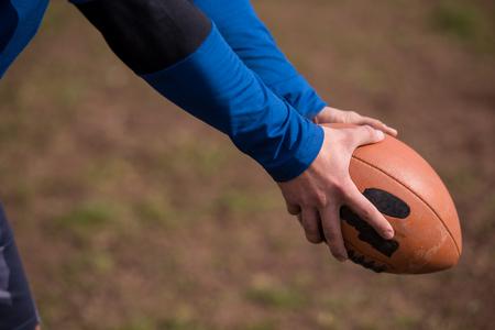 american football kicker practicing football kickoff closeup shot Banque d'images - 110536208