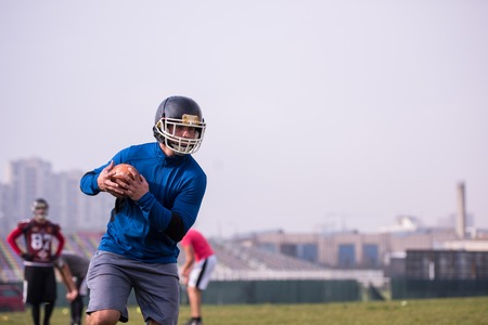 group of young american football players in action during the training at field Stock Photo