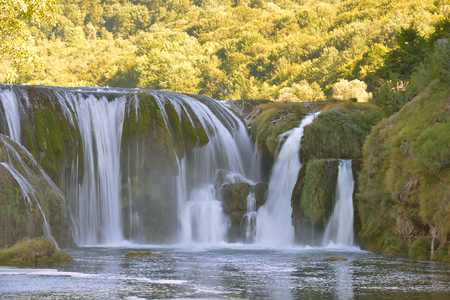 Waterfall on wild river with fresh drinking water in summer Stockfoto