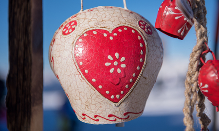 traditional cow bells as home decoration or gift  in tyrol Austria at winter Stock Photo