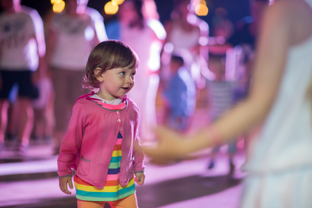 little cute girl carefully spending time while dancing in the kids disco