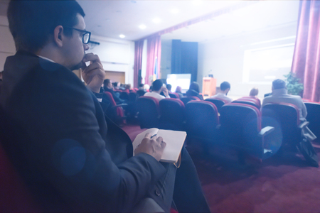 young people taking notes on education training  business seminar at modern conference room