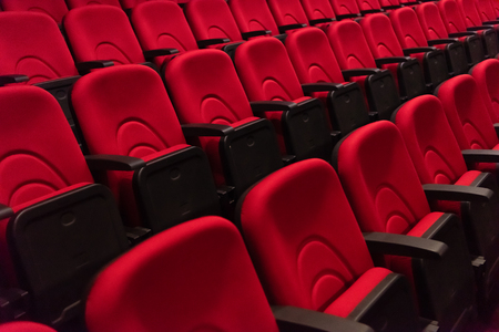 Empty conference,theater or cinema hall with rows of red seats