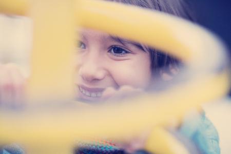 cute little boy having fun in playground park on cludy autum day