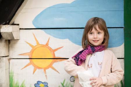 cute little girl portrait while  having fun in playground park on cludy autum day Stock Photo