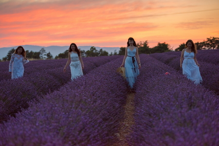 group of famales have fun in lavender flower field on beautyful sunset