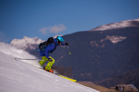 Young athlete freestyle Skier having fun while running downhill in beautiful Alpine landscape on sunny day during winter season Stock fotó