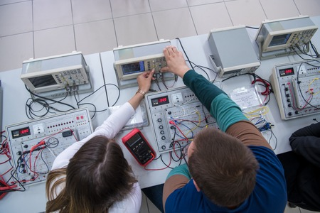 Top view of a Group young students doing technical vocational practice in the electronic classroom, Education and technology concept