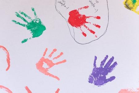 Child colorful hand prints on white Banco de Imagens